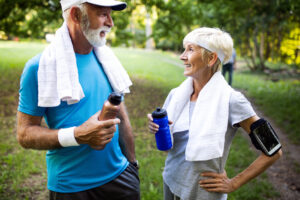 Active and sporty senior couple engaging in healthy sports activies