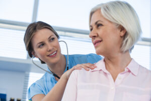Alpine Cardiology - Female doctor with female patient in office