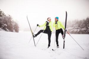 Alpine Cardiology Senior couple cross-country skiing.