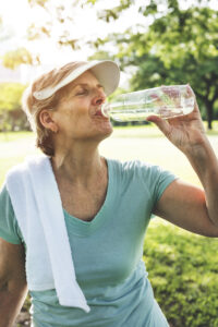 Alpine Cardiology Senior drinking water after exercising