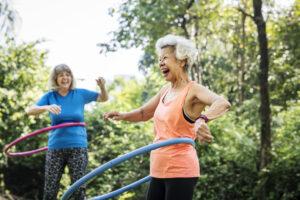 Alpine Cardiology Senior woman exercising with a hula hoop